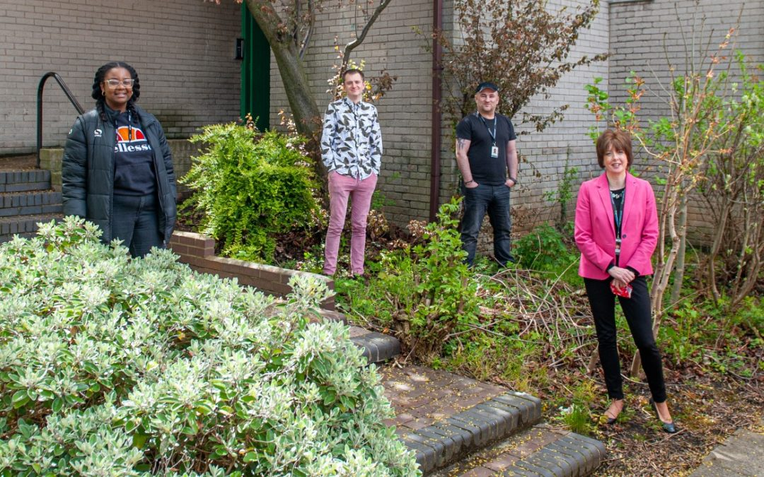 Charity staff and the people it helps create urban garden at homeless drop-in